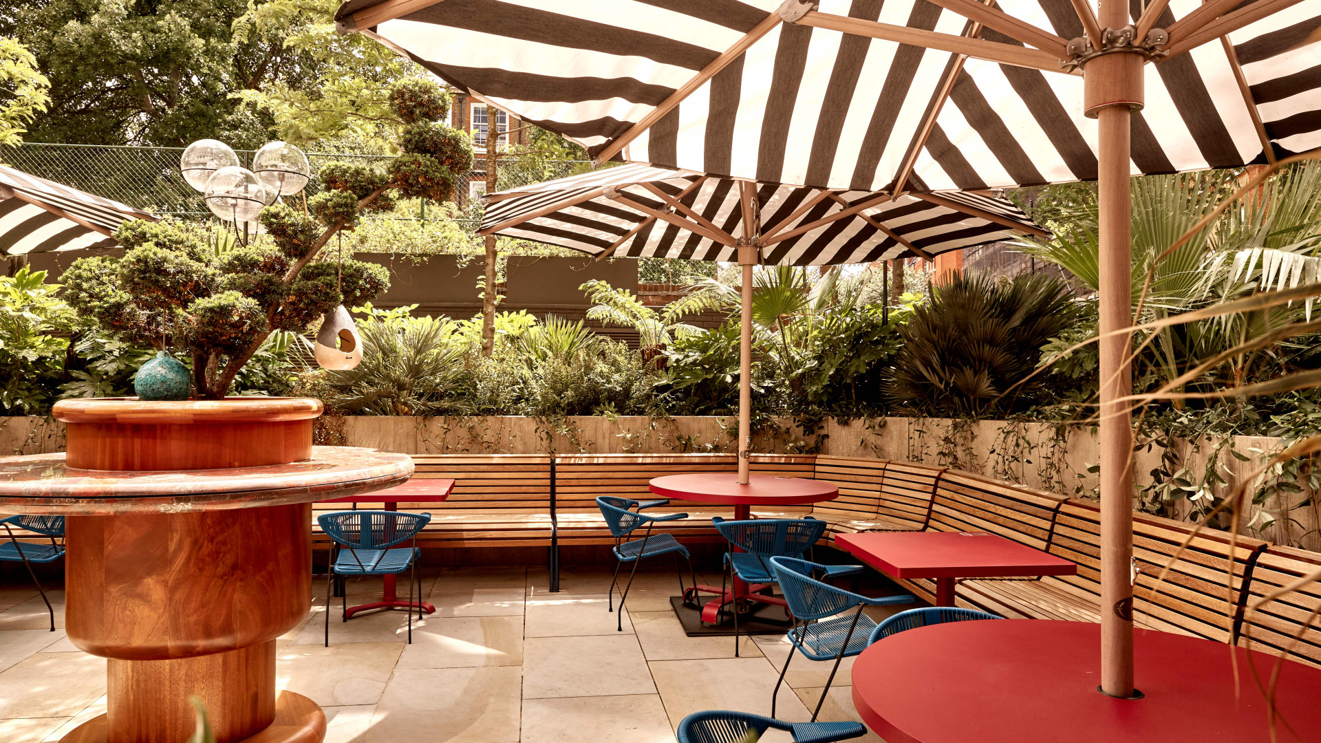 A photo of the Double Standard terrace at The Standard Hotel, King's Cross, in the sunshine
