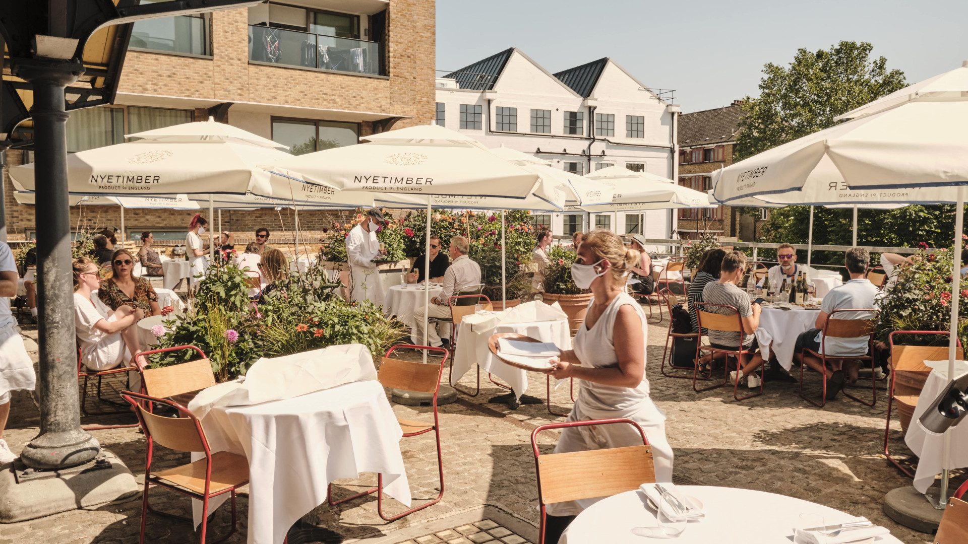 This is a picture of the terrace at FLORA restaurant at JOY in Portobello, West London, in the sunshine