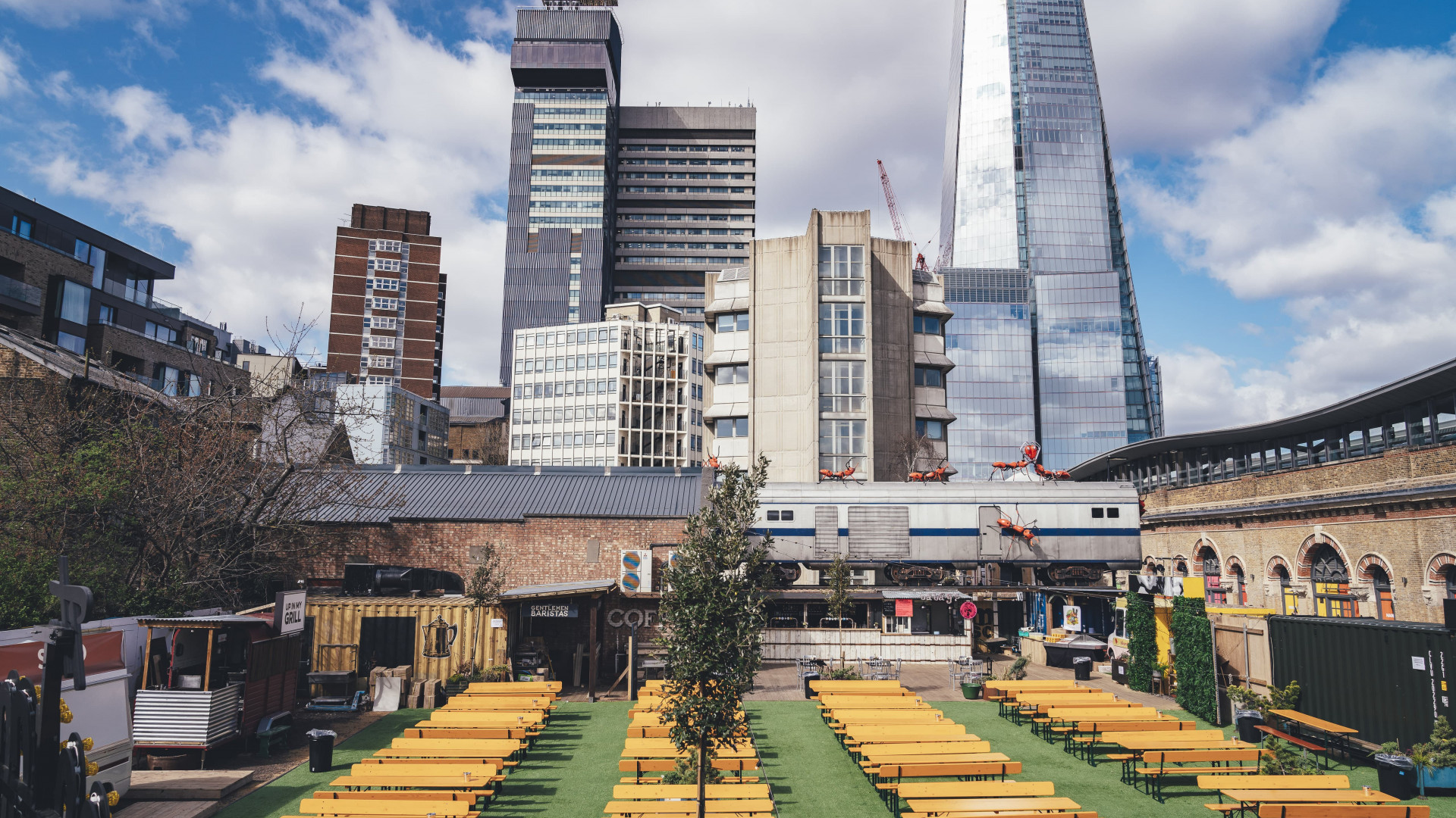 A photo of Vinegar Yard in London Bridge, a large outdoor drinking space with benches