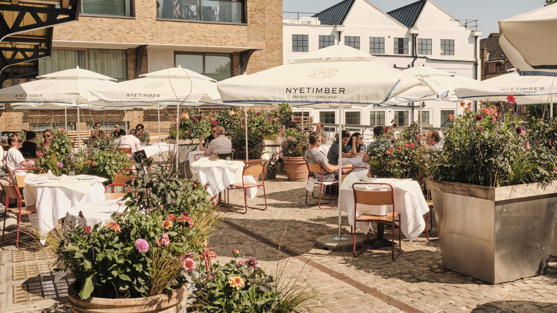 This is an image of the outdoor terrace at JOY at Portobello Docks in London.