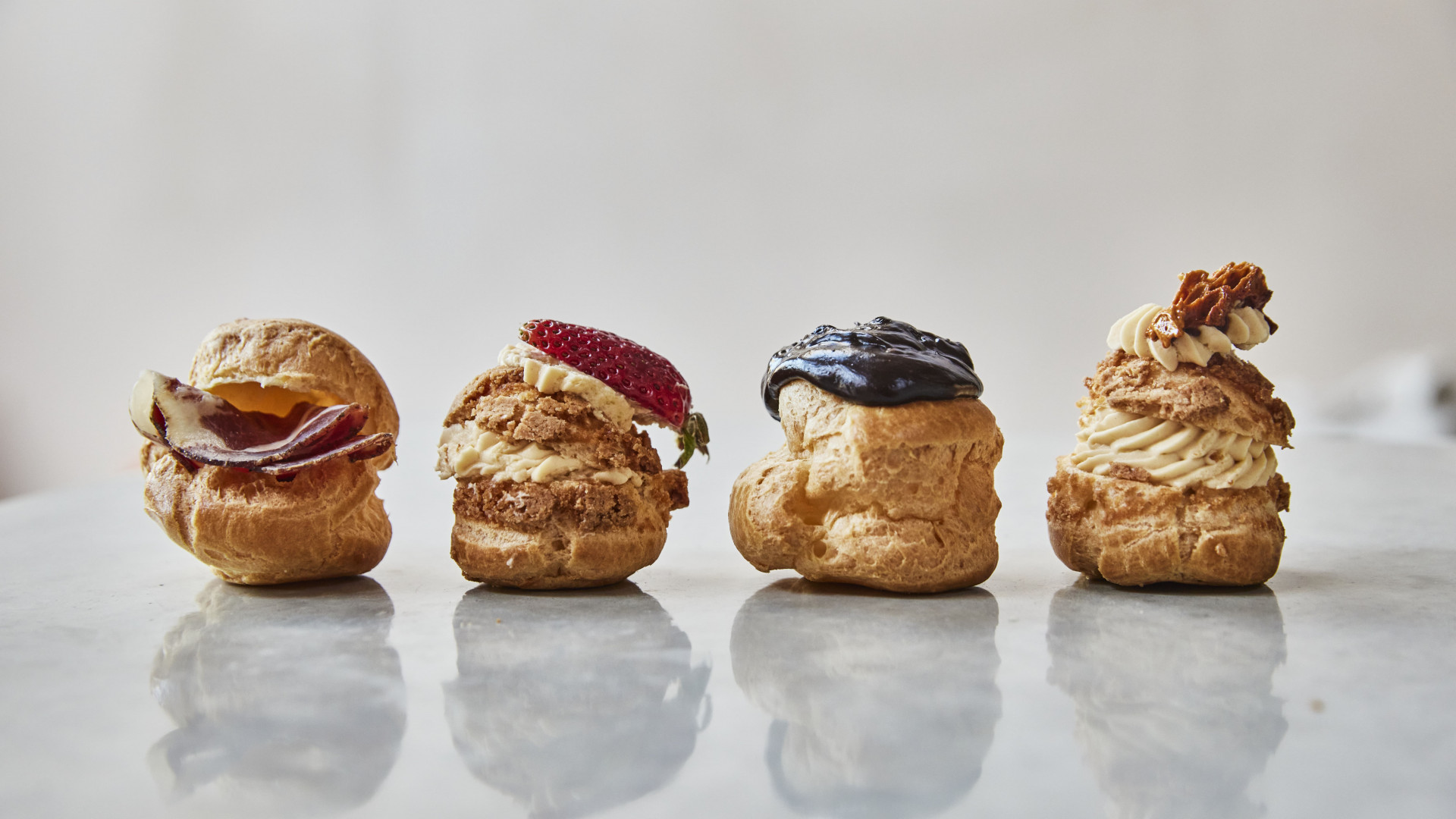 This is an image of the sweet and savoury profiteroles on The Proof's afternoon tea
