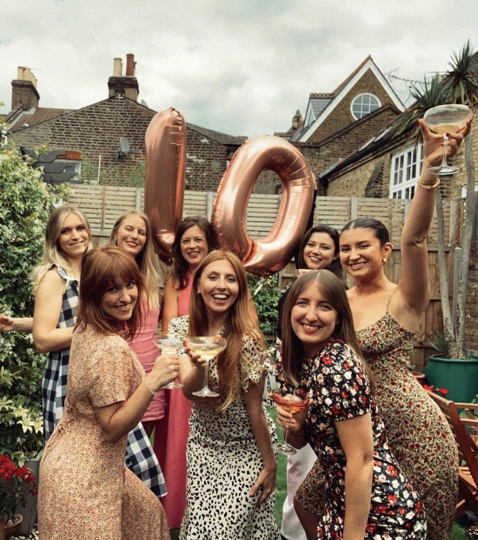 This is a photo of Team Tonic celebrating the company's tenth birthday.